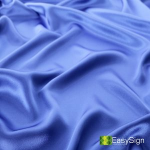 Blue shiny satin background.