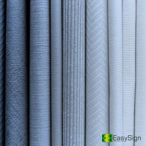 Blueish fabric stacks textured background